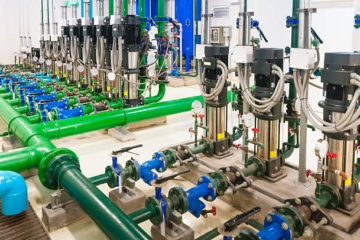 Water pumping station, industrial interior and pipes  .